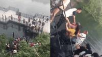 景区吊桥断裂10多人落水 客运司机带头救人