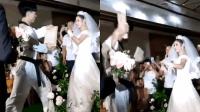 新婚宴席上新娘表演空手劈木板