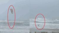 艺高人胆大! 一男子抓着风筝 如骑野兽般在飓风中冲浪