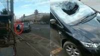 撞见妻子坐别人车 男子怒将轿车砸个洞