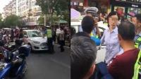 女子违停耍横拒检查 交警顶着车辆将其逼停