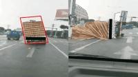 小货车超载上路  车体失衡路中翻车