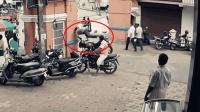 悲剧! 监拍: 摩托车司机撞墙被甩飞幸无大碍