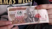 在老挝花钱得小心, 一不留心就看错, 那么, 这张钞票面额是6万?