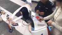 """网红女跟风趴斑马线上拍短视频""""炫富摔"""" 被民警罚款"""