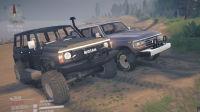 旋转轮胎泥泞奔驰经典的陆巡LC60尼桑Y60攀爬大石头