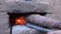 荒野生存  原始技能 生存哥 在原始火箭炉上用粘土烤鱼