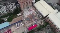 航拍福州村民自建楼房倒塌现场铲车正在清理建筑残骸