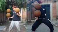 80后男子花式耍篮球:两个篮球摞一起在指尖旋转