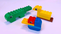 积木拼装四种动物,有小鸭子,颚鱼,长颈鹿,蜗牛