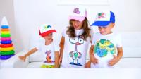 萌娃们穿戴上了自己绘画的帽子和衬衫,还挺漂亮呢!小家伙们画的可认真了!