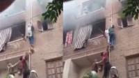 小伙徒手爬楼火灾中救出3名儿童 网友:真正蜘蛛侠