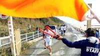 """去日本旅游,只要看到有人挥""""橙色""""旗子,啥也别问直接跑"""