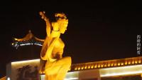 夜观敦煌城标建筑反弹琵琶,展现了飞天女神的纤纤神韵
