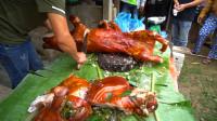 越南街头实拍,全是卖烤全猪的,10万越南盾一斤,折合人民币30块