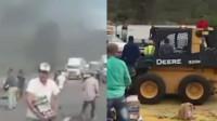 两车相撞民众哄抢遍地冷饮 司机被困车中被活活烧死