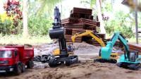 勤劳的挖掘机帮助翻斗车装满了石子,它们这是要做什么呢