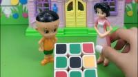 围裙妈妈带大头儿子来到玩具城,大头儿子在拼魔方,怎么才能拼好呢