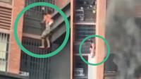 揪心!长沙一高层住宅失火 老人背着小孩顺着防盗窗往下爬