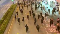欺软怕硬!香港蒙面暴徒群殴男子致面部出血 见港警出动四散而逃