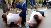 小三当街被四女子围殴扒衣,男子痛哭用身体全力保护被打女子