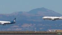 两架飞机同时降落到机场,很少见!