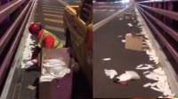 心疼!3200只口罩飘落跨海大桥 形成白色长带绵延百余米