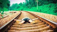 火车开过来时,人躺在铁轨中间能活命吗?看完解开多年疑惑