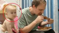 爸爸独自吃着烧鸡腿,8个月宝宝馋哭了,下一秒反应令妈妈笑翻
