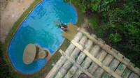 牛人亲手掏出一个露天泳池滑梯,跳下去的瞬间,我也想玩!