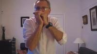 Paul Lamb plays a Sonny Terry style harmonica slow blues