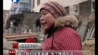 河南电视台都市报道:唐河县占道简易房  三年未拆除