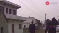 小伙子开车走农村路遇到村霸收过路费  直接开车就给他撞上去_8