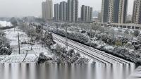 雪天 T31次 HXD3D0531 通过沪昆线K141KM海涛路跨线桥