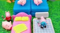 家人们把床让给小猪们睡,自己睡到地上,乔治看到家人床上都是小猪很惊讶