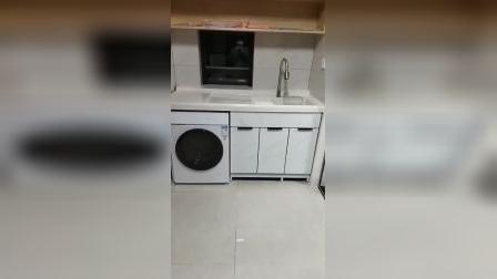 黑色极窄门框配大理石纹太空铝阳台洗衣柜