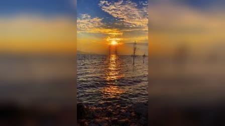 日出东方催人醒,我在洱海边上看风景
